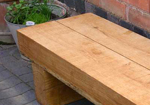 double width turns an outdoor garden bench into a table