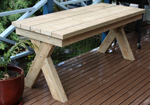Crossed legged timber tables