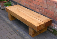 A solid double park bench