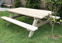 Conventional A frame solid timber table and seat for parks