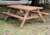 The most common form of outdoor dining in cafes and public areas is the old fashioned A' frame picnic table