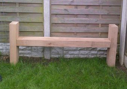 A high sided seat from benches made from sleepers and cleanly sanded back